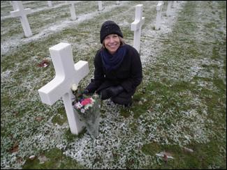 Woman by Cross Headstone in cemetary