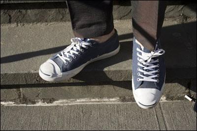 Feet wearing sneakers